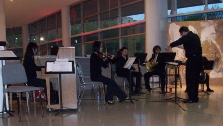 """Performance of """"Elegy"""" for Pierrot ensemble during conTemplum's Tyler/Boyer Collaboration, with accompanying artwork by Kristen Moore. April 14, 2010."""
